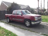 Photo Red 2005 chevy silverado extra cab 4 doors