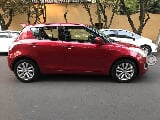 Foto Suzuki Swift GLX manual Rojo 2015