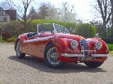 Photo 1951 Jaguar XK120 Roadster Carmen Red w Wires,...